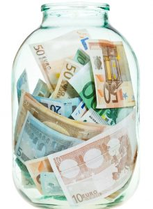 saving euro money in glass jar isolated on white background